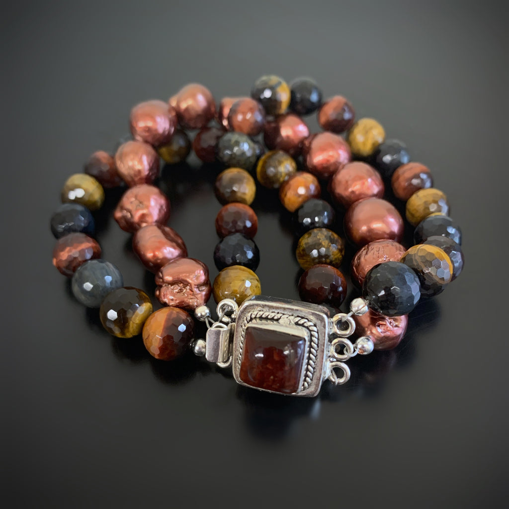 red, blue and brown tigers eye bracelet with ornate clasp and freshwater pearls.