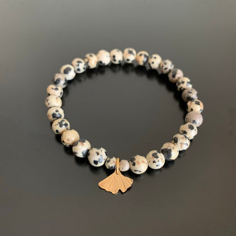 dalmatian jasper stretch bracelet with gold brass ginkgo charm