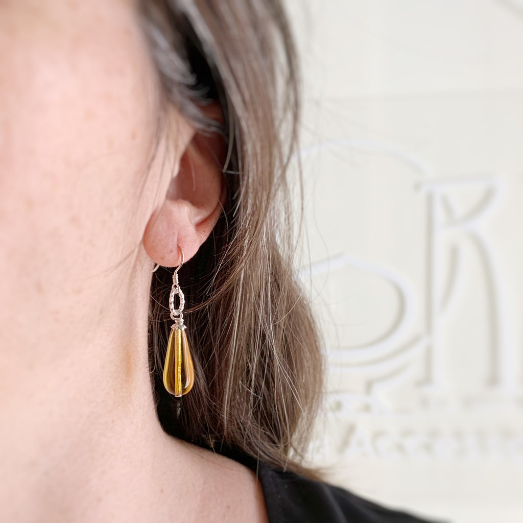 amber glass teardrop earrings with sterling silver ear wires and twisted circle motif