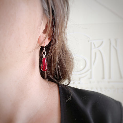 red glass teardrop earrings with sterling silver ear wires and twisted loop