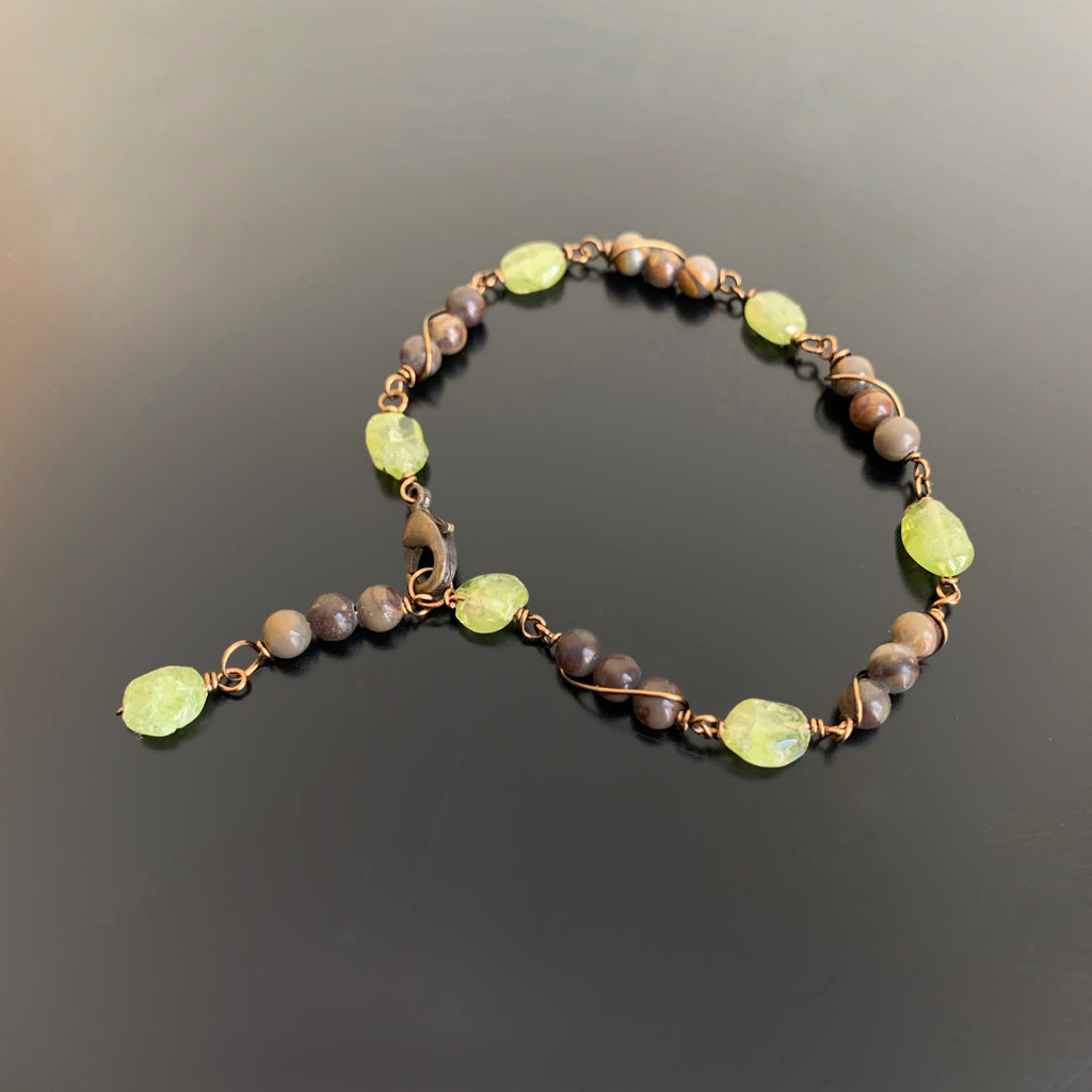 peridot and earth tone beads in a wire wrap link style bracelet