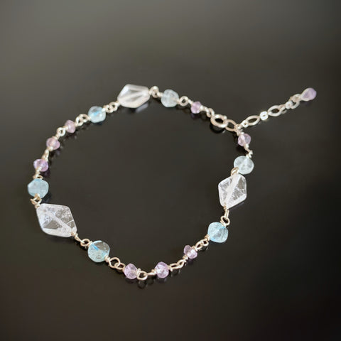 hand wrapped sterling silver bracelet with clear quartz, amethyst, and aquamarine