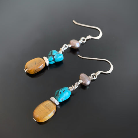 long, slender and lightweight earrings of tiger eye, turquoise and freshwater pearls.