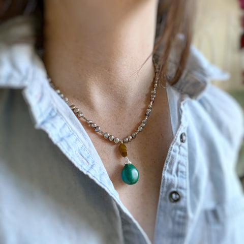 turquoise and tiger eye drop on a warm grey freshwater pealr necklace