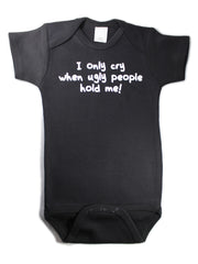 I only cry when ugly people hold me Funny baby one piece bodysuit Black with white