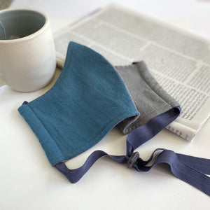 Pacific Shadow grey and blue organic cotton BringIt! mask with magazine and coffee