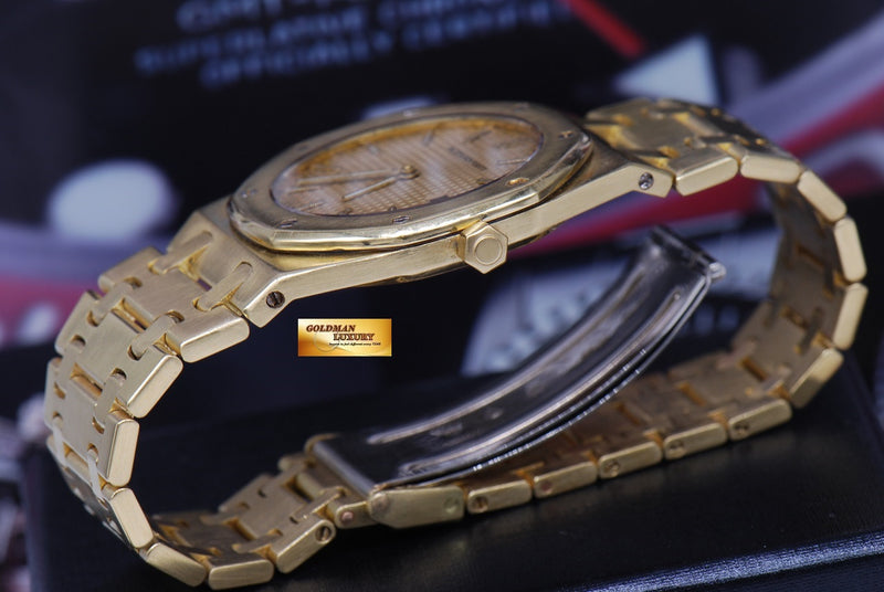 products/GML1089_-_Audemars_Piguet_Royal_Oak_18K_Yellow_Gold_35mm_Quartz_NEAR_MINT_-_10.JPG