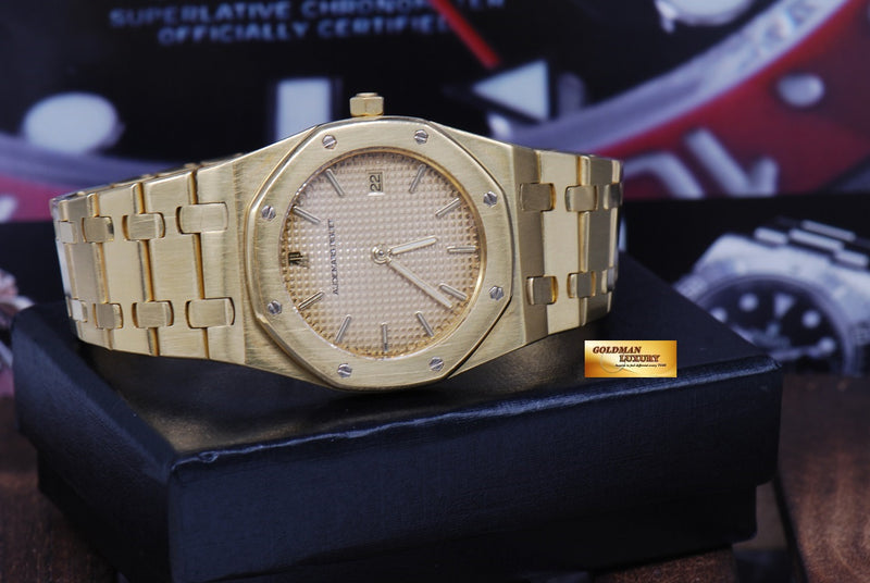 products/GML1089_-_Audemars_Piguet_Royal_Oak_18K_Yellow_Gold_35mm_Quartz_NEAR_MINT_-_13.JPG
