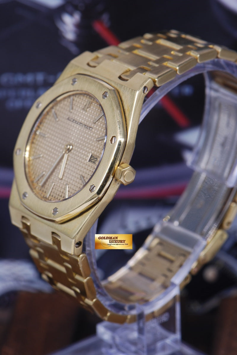 products/GML1089_-_Audemars_Piguet_Royal_Oak_18K_Yellow_Gold_35mm_Quartz_NEAR_MINT_-_2.JPG