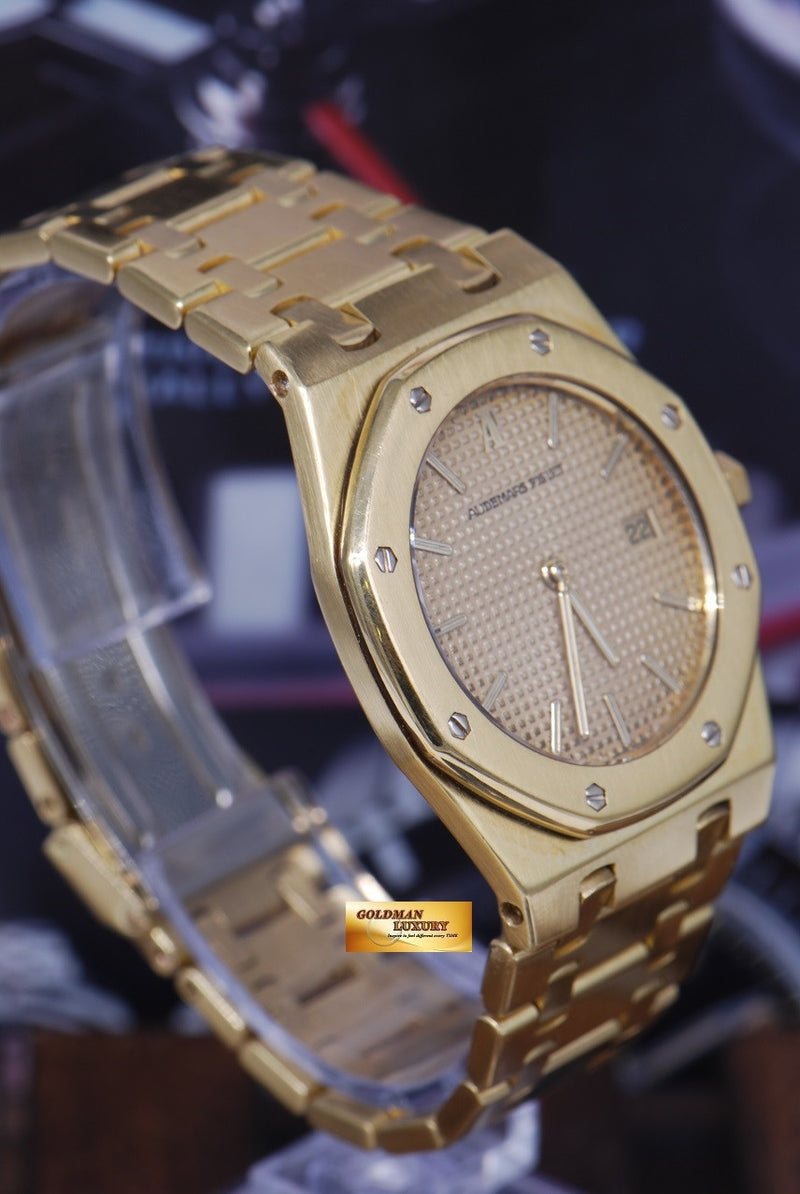 products/GML1089_-_Audemars_Piguet_Royal_Oak_18K_Yellow_Gold_35mm_Quartz_NEAR_MINT_-_3.JPG