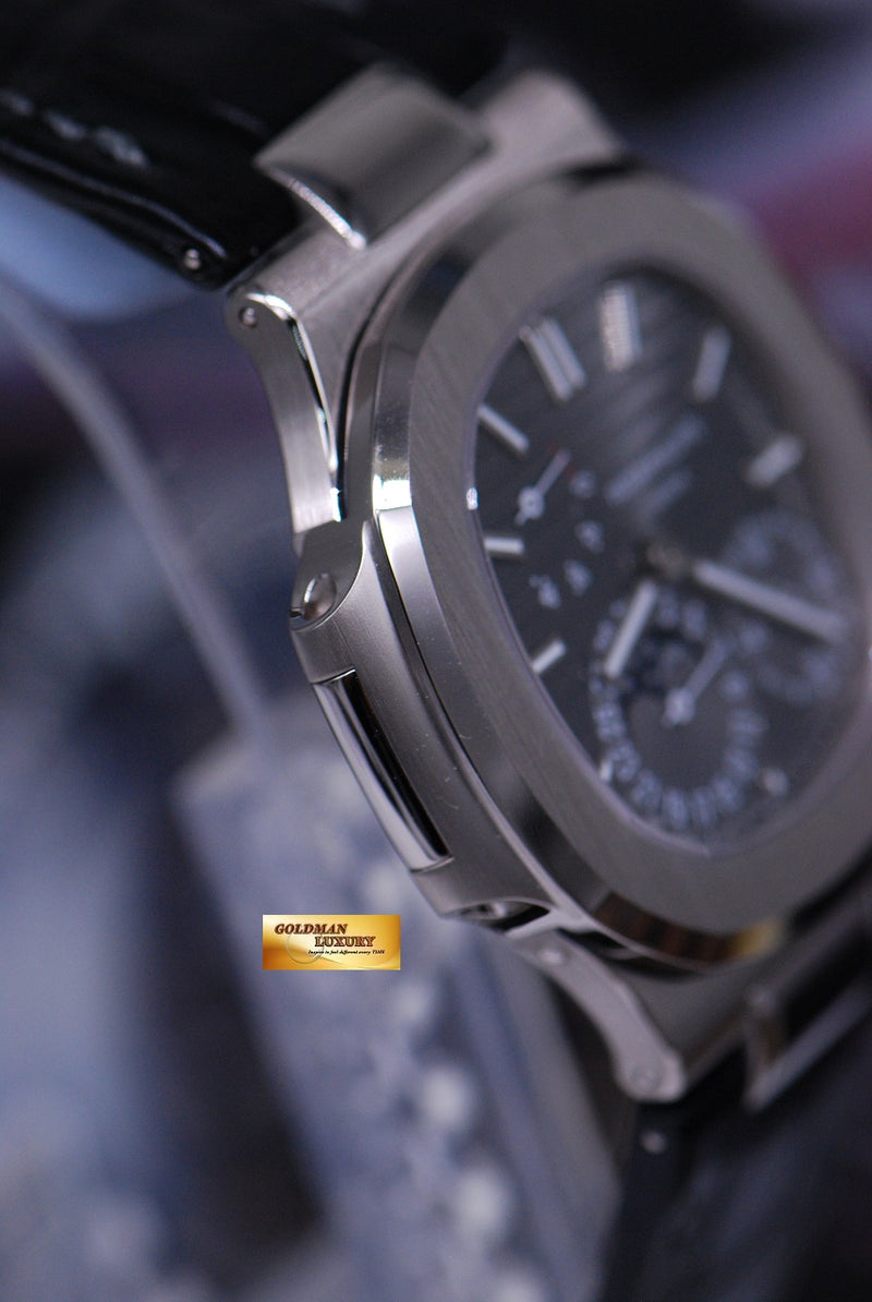 products/GML1490_-_Patek_Philippe_Nautilus_Power_Reserve_Moonphase_18KWG_5712G_NEW_-4.JPG