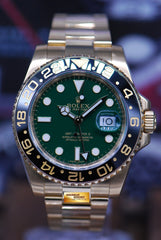 ROLEX OYSTER PERPETUAL GMT-MASTER II 18K YELLOW GOLD GREEN DIAL CERAMIC BLACK 116718 (MINT)