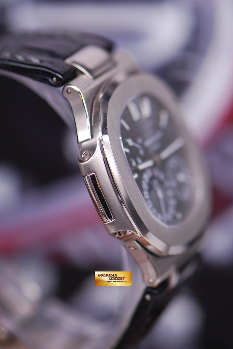 products/GML1648_-_Patek_Philippe_Nautilus_18KWG_Moonphase_Power_Reserve_5712G_-_4.JPG