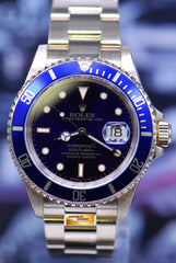 ROLEX OYSTER PERPETUAL SUBMARINER 18K YELLOW GOLD BLUE 16618 (MINT)
