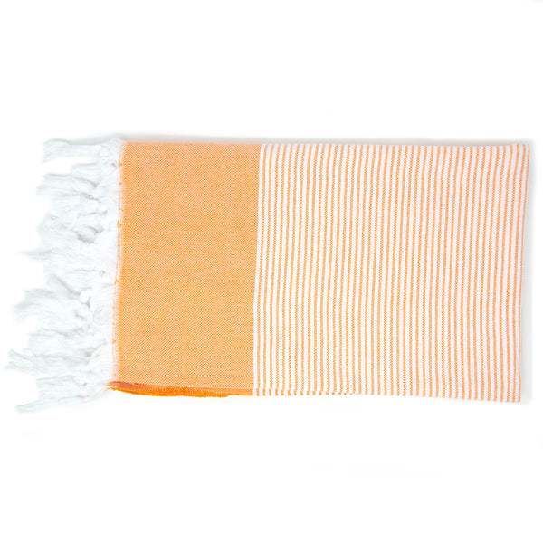 Orange towel with white stripes and tassels