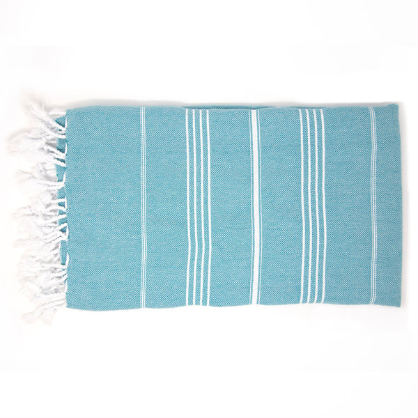 Dark turquoise beach towel with thin white stripes and tassels