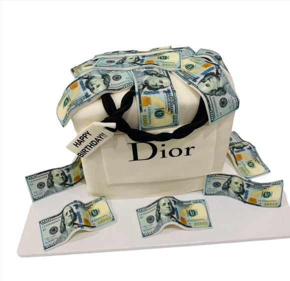 This Dior Branded Birthday Cake comes with any flavor of your choice. Wrapped in fondant, all the money is edible print and can come in any unique design you can think of! #diorcake,