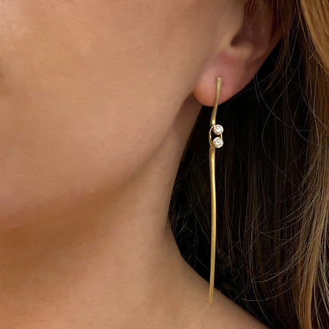 Ayesha Mayadas driftwood earring in 18K gold with diamonds