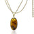 Oval Amber pendant in 18K gold.
