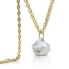 Baroque pearl pendant with 18K yellow gold bail