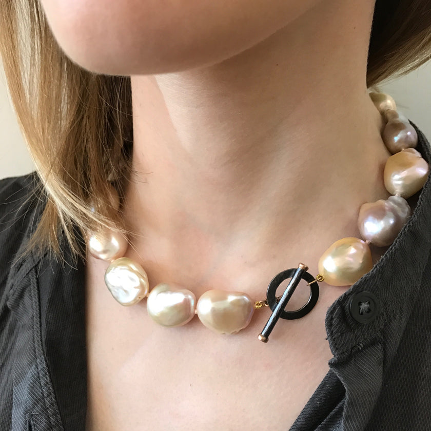 Large pink baroque pearls in a necklace with 18K gold and silver clasp