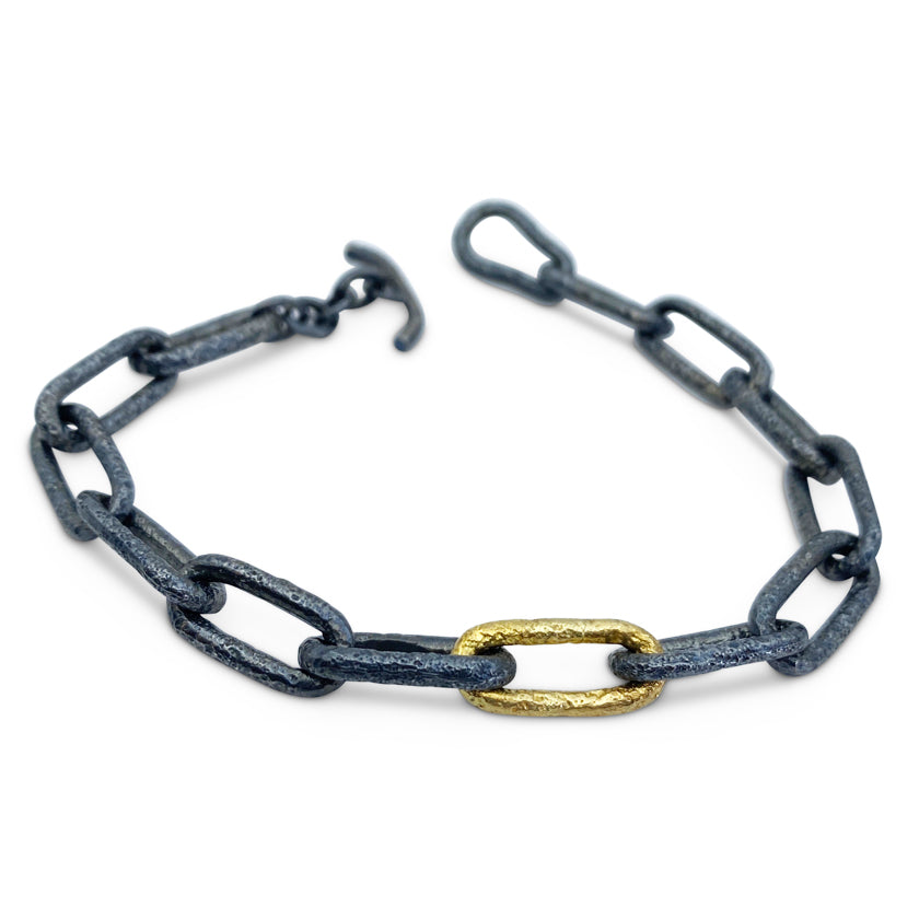 """Playground chain"" 18K yellow gold and sterling silver bracelet"