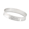 Narrow forged cuff in sterling silver (white) with top closure and black diamonds