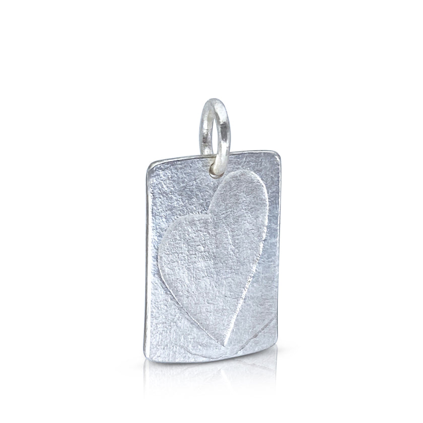 Hand forged sterling silver heart pendant