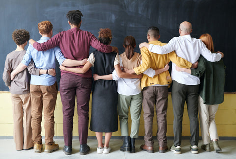 A group of people forming a wall by linking arms