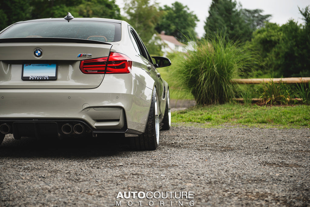 F80 M3 in Fashion Grey, Lowered on a KW HAS Kit, with BBS LM Wheels, an Akrapovic Exhaust, and a Vorsteiner Rear Carbon Fiber Diffuser.