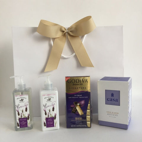 Spa gift with lotion, shower gel, chocolate and candle