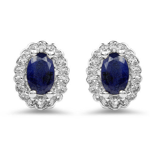 Blue Sapphire And White Topaz Earrings In Sterling Silver