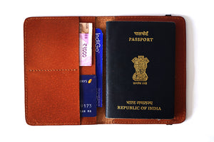 Tan passport cover with utility, front open