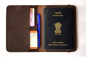 Brown passport cover with utility, front open view