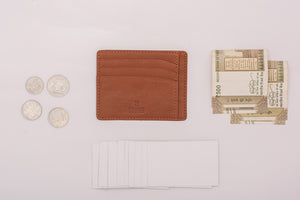 Tan card holder for cards cash and coins