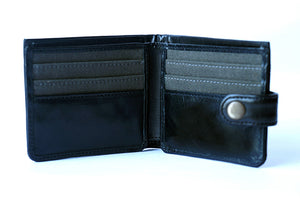 Men's black genuine leather wallet with button, open front view