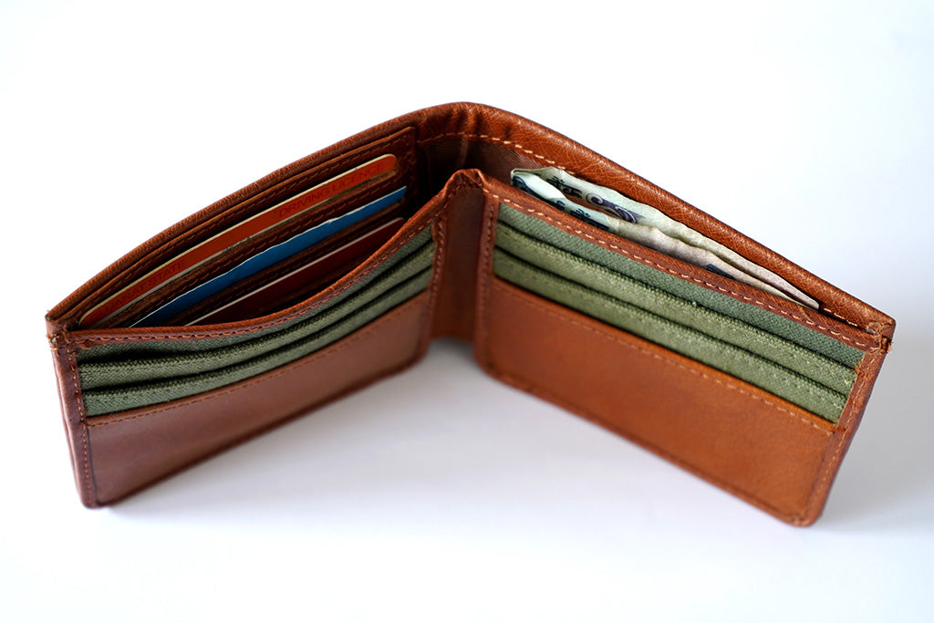 Tan leather wallet for men, top view with 11 cards and 1 cash pocket