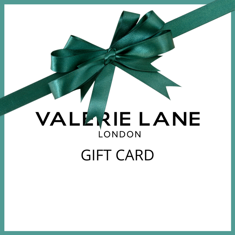 Gift card with aqua green ribbon tied as bow