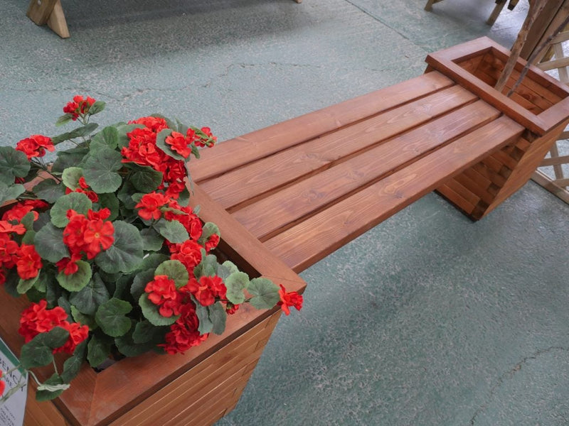 Planter bench with red flowers