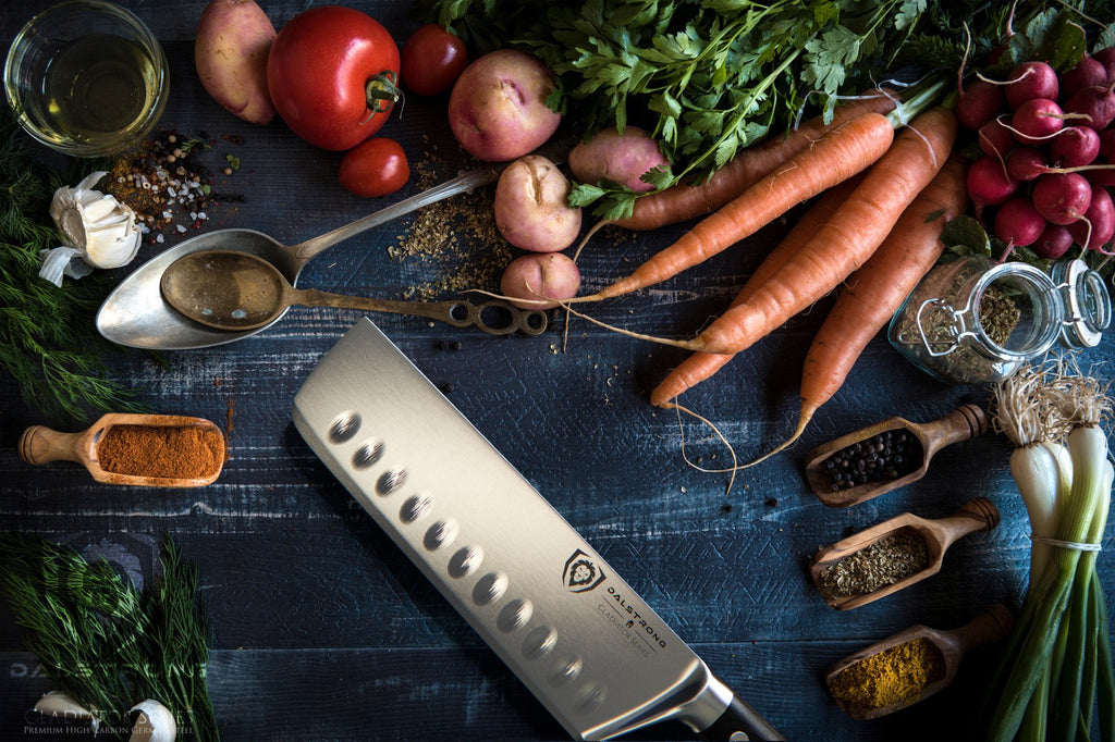 Nakiri knife surrounded by several vegetables