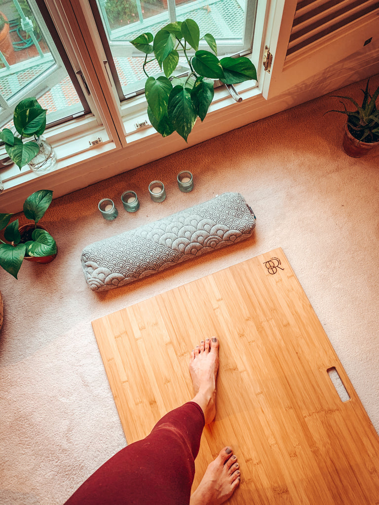 bamboo yoga board rest on a carpet near a window (don't forget the pedicure)