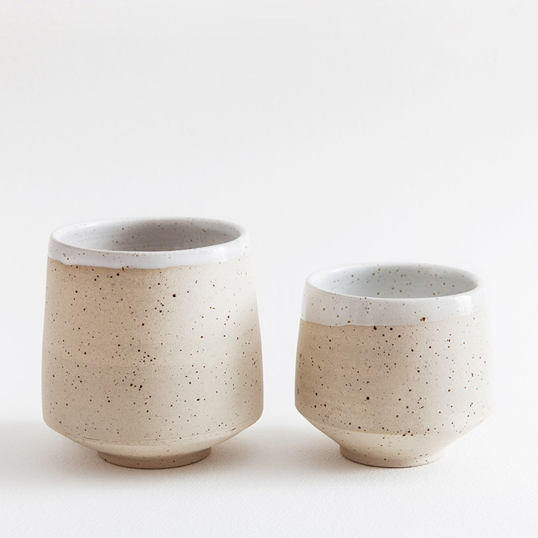 Two speckled mugs