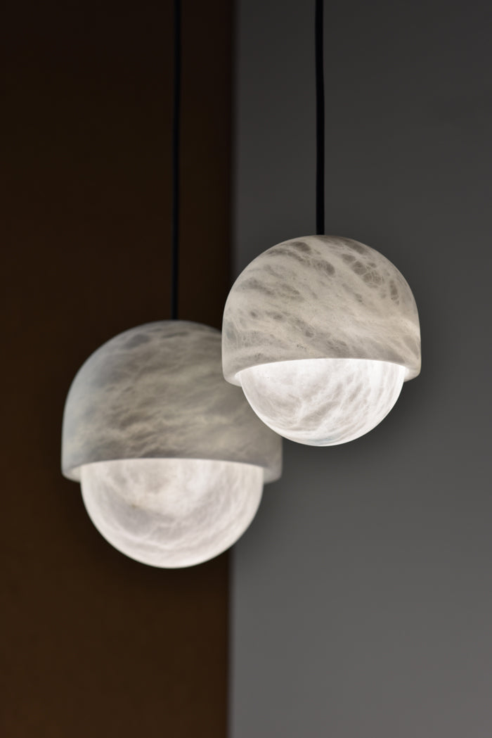 Two rounded lampshades hanging