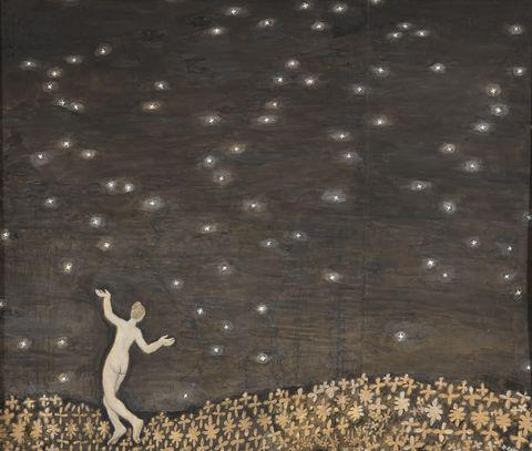 A woman walking under the stars