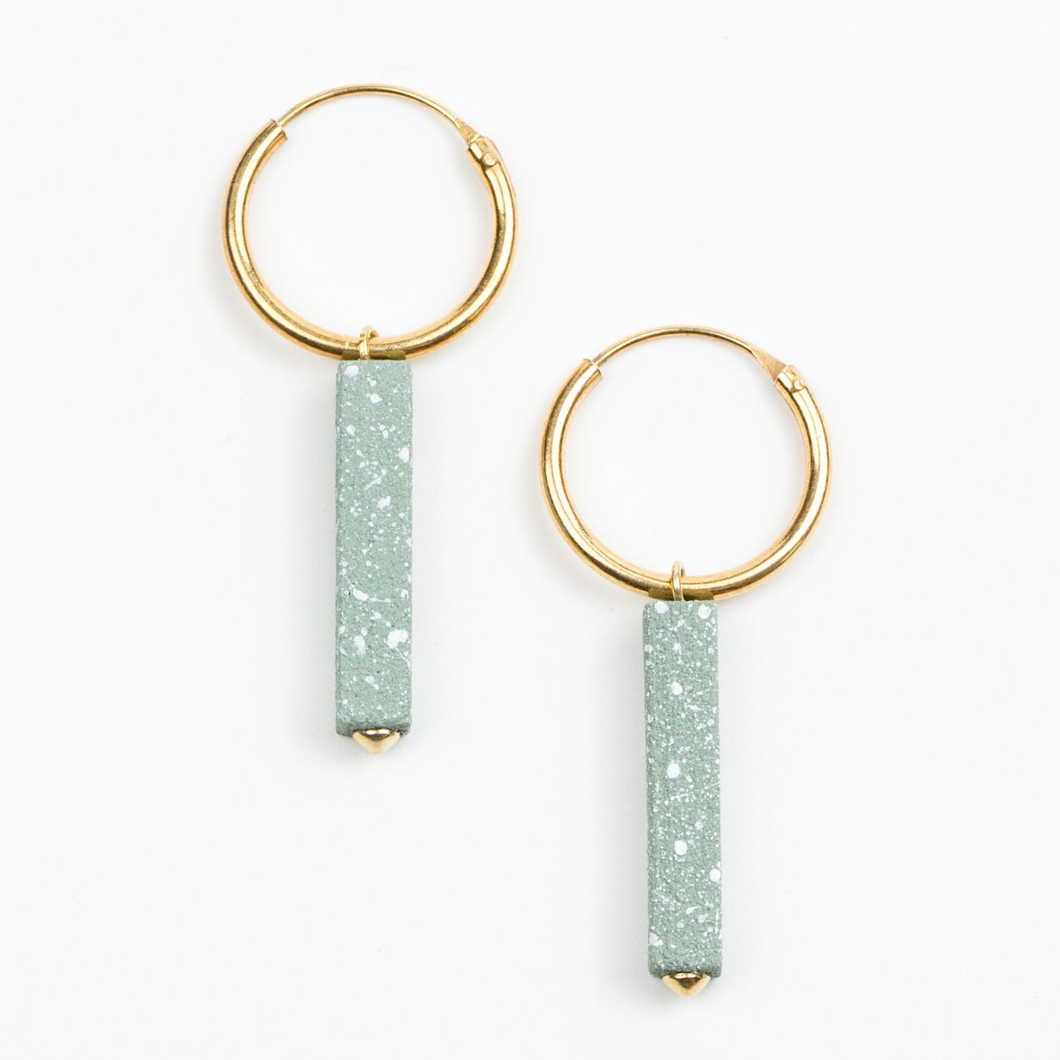 A pair of green speckled earrings