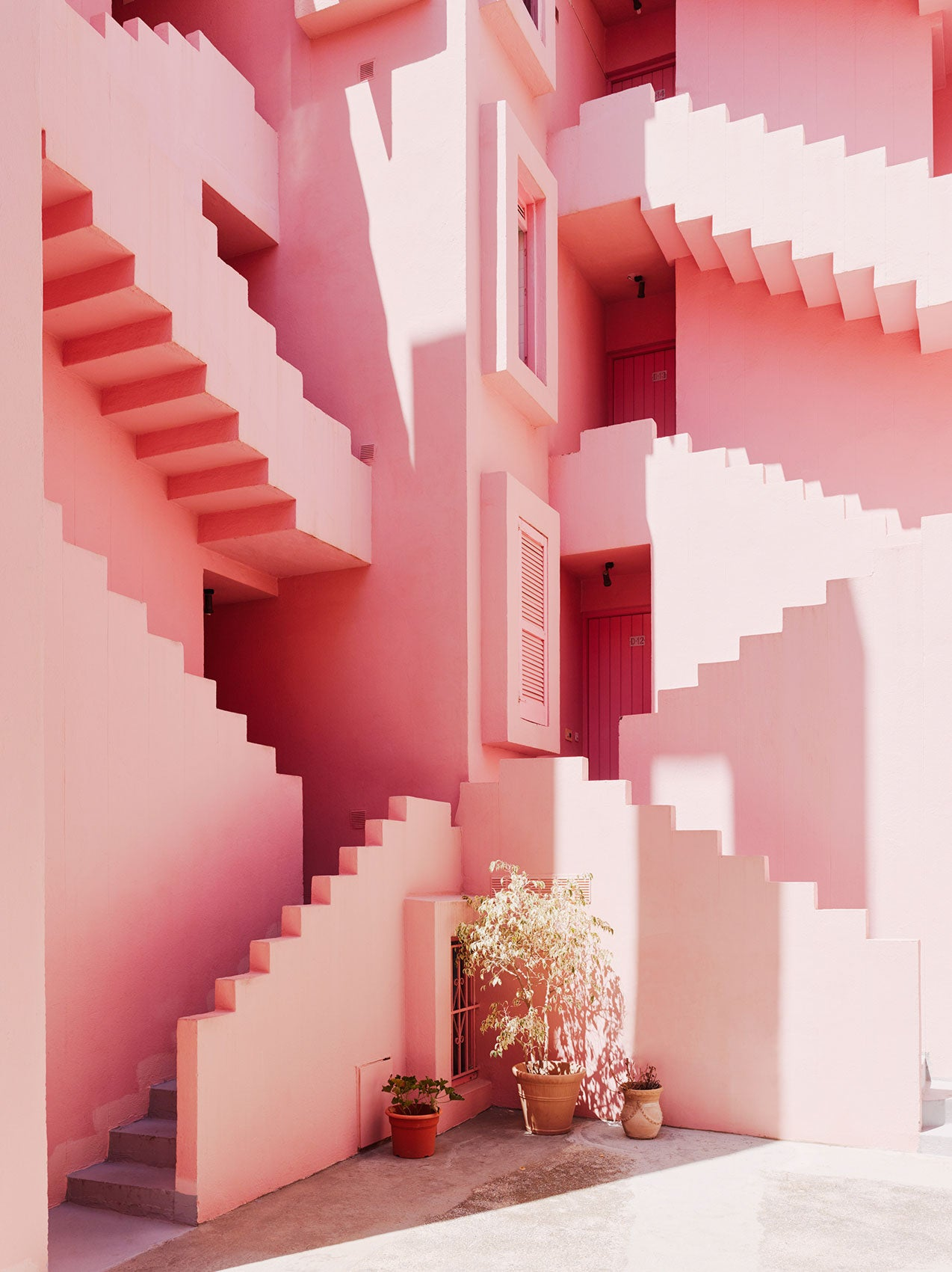 Pink concrete house with stairs