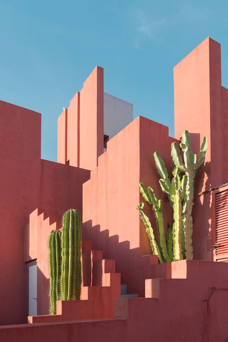 Pink concrete house with trees
