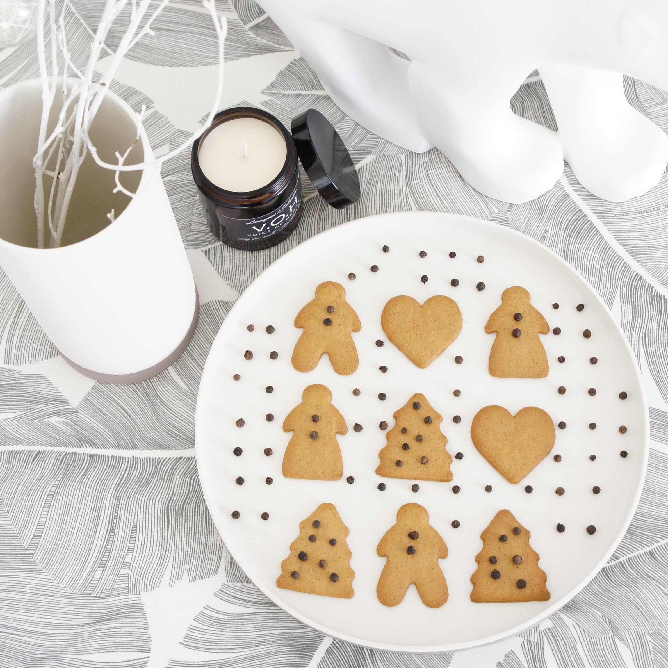 Gingerbread biscuits on a white platter