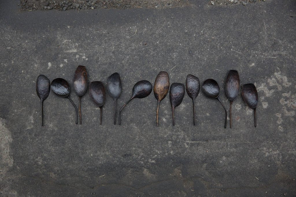Small wooden spoons in a row