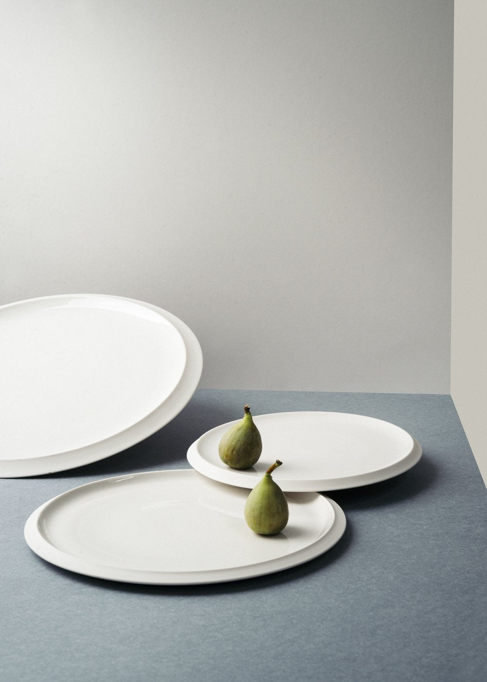 Grey platters and figs